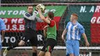 Warrenpoint goalkeeper Jonathan Parr collects the ball from Johnny Addis during Glentoran's 3-0 Premiership win