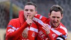 Darren Murray is congratulated by Gary Twigg after scoring his side's decisive penalty against Ballymena