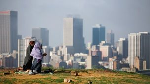 People pray on a hill above Johannesburg S Africa (8 Dec 2013)