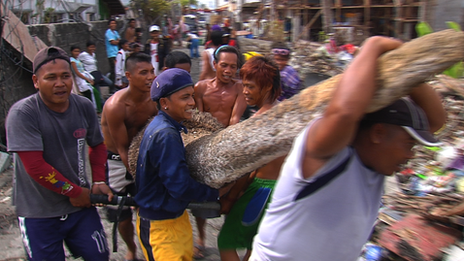 Clearing debris in Tacloban