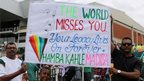 Cricket fans hold a sign in Durban, South Africa (8 Dec 2013)