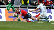 Keith Earls scores Munster's third try despite the efforts of James Hook