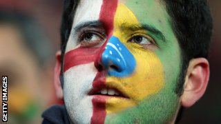 A fan sporting an England and Brazil face paint at the friendly between England and Brazil.