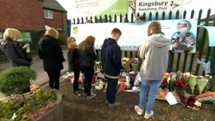 Pupils and parents paying their respects to crash victims