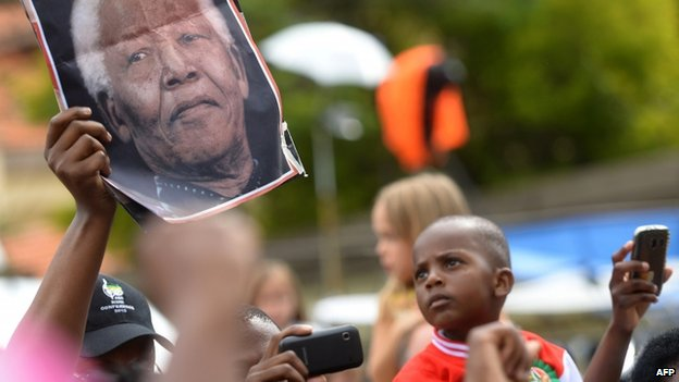 Crowds continued to gather outside Nelson Mandela's home in Houghton