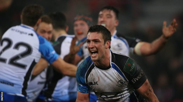 Dave McSharry celebrates Connacht's success as other team-mates embrace in the background