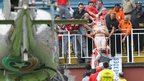 Injured Brazilian football fan being transported out of stadium