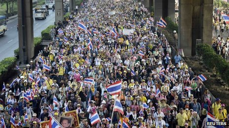Anti-government protesters march during a rally in Bangkok 9 December 2013