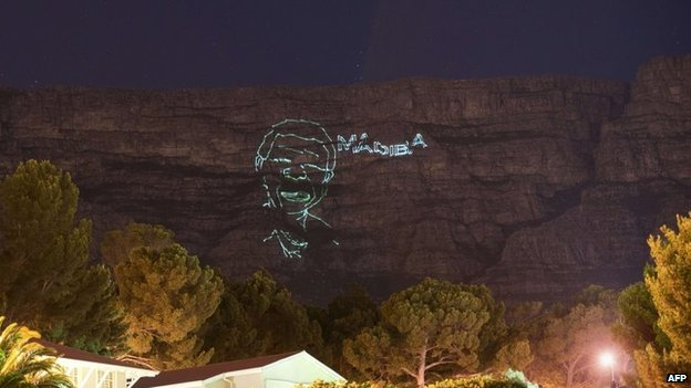 A lighting installation showing a face of Nelson Mandela, shines on Table Mountain, to commemorate the life of late former South Africa President Nelson Mandela
