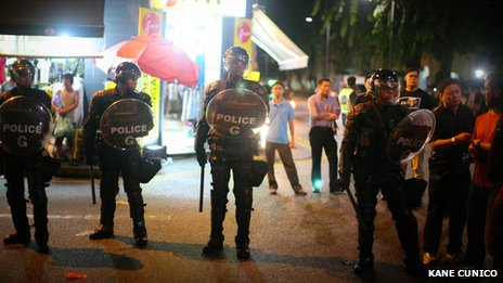 Police in riot gear in Little India, Singapore, 8 December 2013
