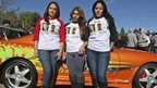 Fans wear shirts commemorating Fast & Furious star Paul Walker and Roger Rodas during an unofficial memorial event in Santa Clarita, California