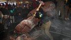 Protesters destroy a statue of Lenin in Kiev, Ukraine