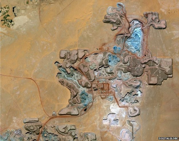 Resembling the patterning in a picture by Gustav Klimt, this image shows the Arlit uranium mine in Niger