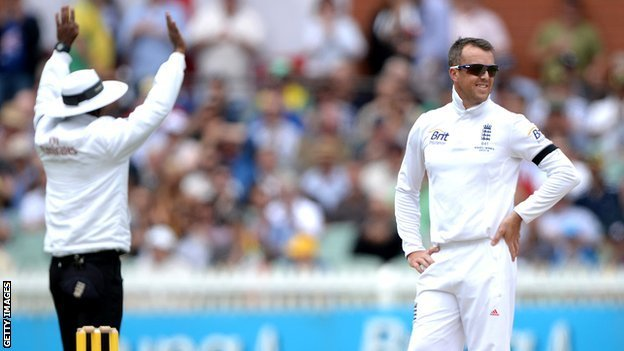 Graeme Swann looks on as his ball is hit for six
