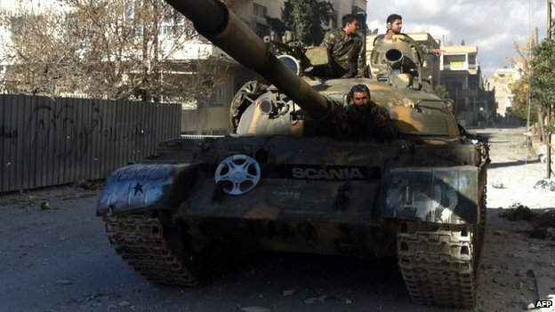Syrian pro-government forces patrol Nabak in a tank (7 December 2013)