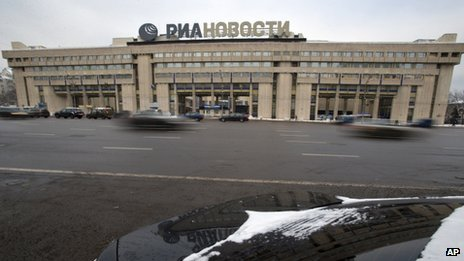 Cars pass by the former Russian RIA Novosti information agency headquarters in Moscow, Russia, Monday, Dec. 9, 2013.