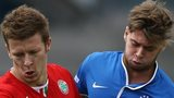 Cliftonville's Stephen Garrett with James Knowles of Linfield