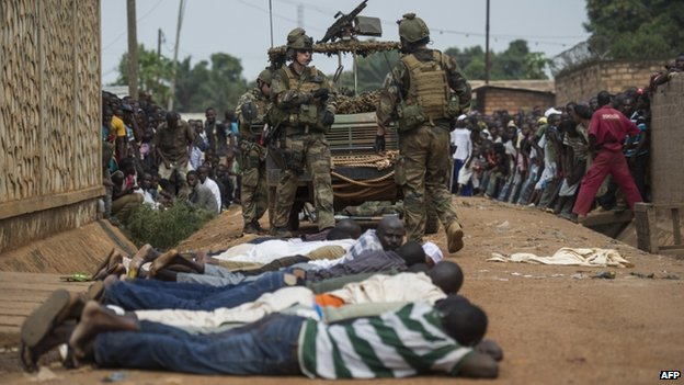 French soldiers arrest ex-Seleka rebels after finding weapons in a house near Bangui's airport, on December 9, 2013