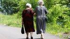 Elderly women out walking