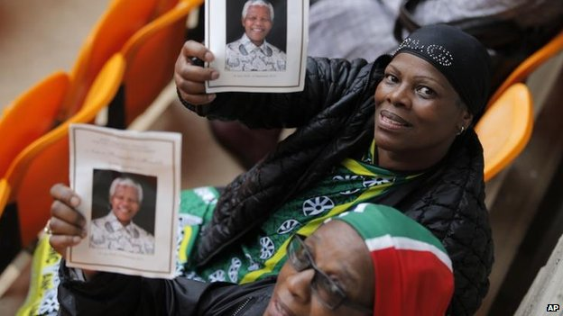 Crowds at a memorial service for Nelson Mandela, 10 Dec
