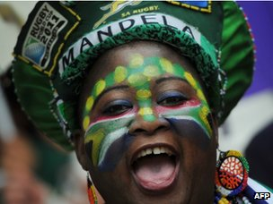 A woman celebrates in the tribune before the memorial service for Nelson Mandela