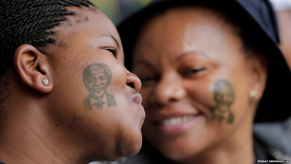 Women with tattoos of former South African president Nelson Mandela