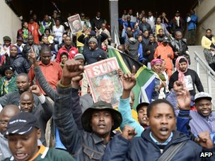 People celebrate as they arrive at Soccer City Stadium in Johannesburg to attend the memorial service for Nelson Mandela
