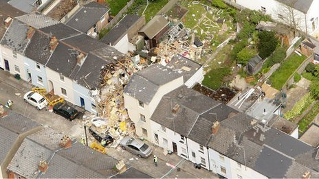 Damaged house shown from the air