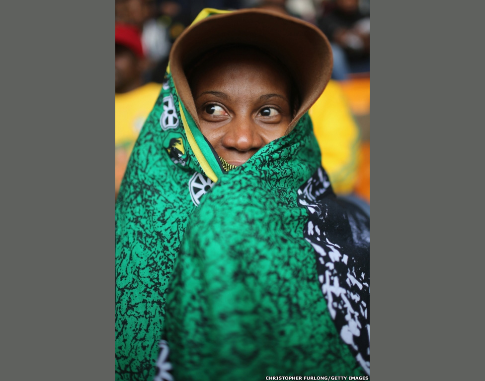 A woman waits for the Nelson Mandela memorial service