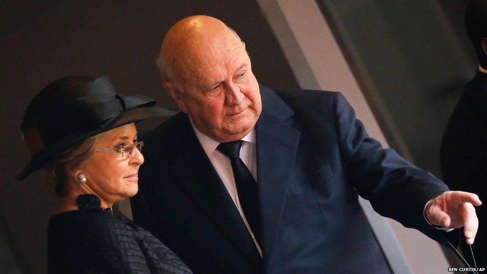 Former South African president FW De Klerk gestures as he arrives with his wife Elita