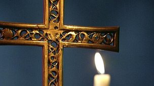 Catholic crucifix and candle