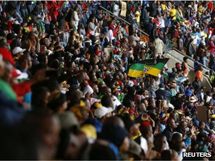 People sing and dance at the First National Bank (FNB) Stadium