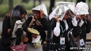 Members of the public walk towards the Nelson Mandela memorial service at the FNB Stadium in Johannesburg