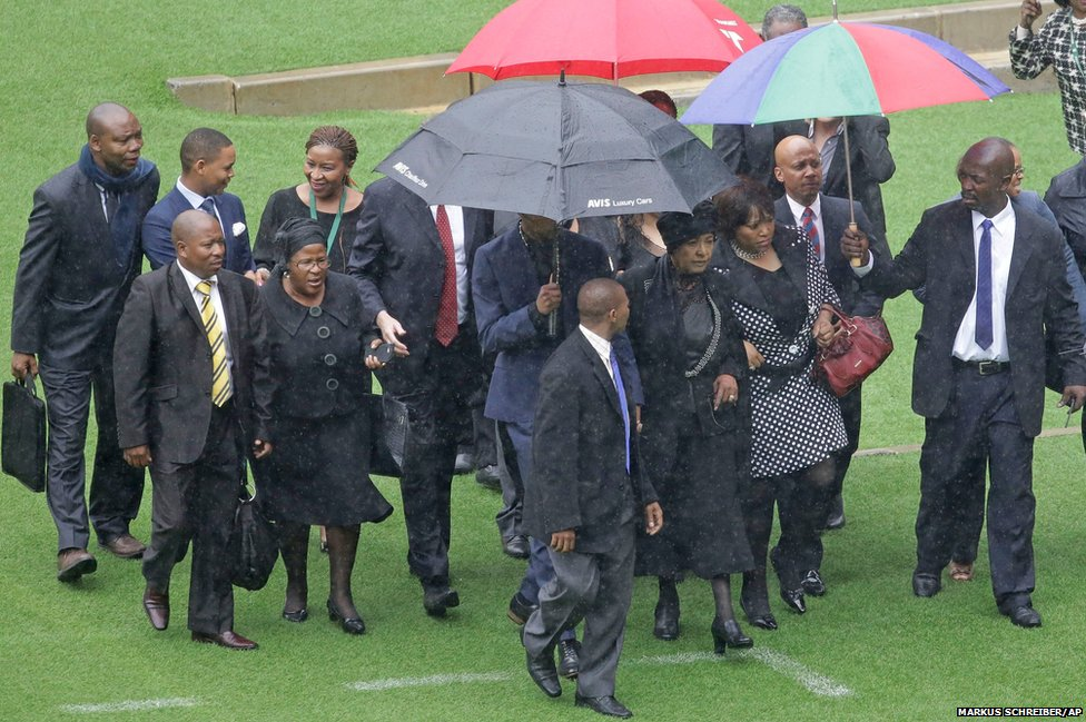The former wife of Nelson Mandela, Winnie Madikizela-Mandela, center right, arrives