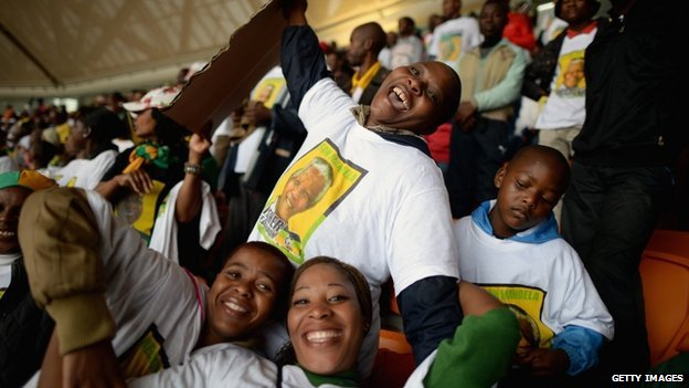 Members of the public attend the Nelson Mandela memorial service at the FNB Stadium, South Africa - 10 December 2013