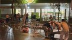 Employees of a supermarket try to recover items left behind by looters after the store was ransacked in San Miguel de Tucuman, Argentina, on 9 December, 2013