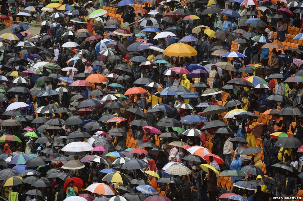 People holding umbrellas