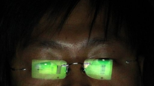 A Chinese hacker working on his laptop