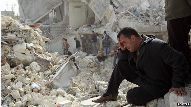 Man cries amid rubble in Aleppo (file photo)