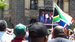 Scene in Cape Town as spectators watch the big screen.
