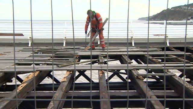 Workman repairing Cromer Pier