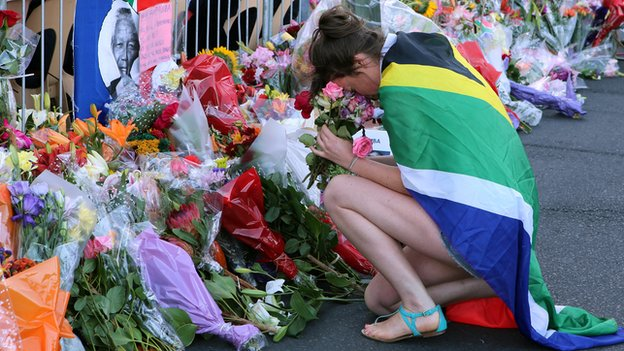 A woman mourns in Cape Town on 6 December 2013