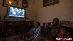 Watching ceremony from their home in Johannesburg