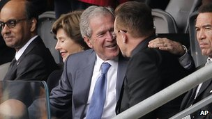 George W Bush embracing Irish rock star Bono