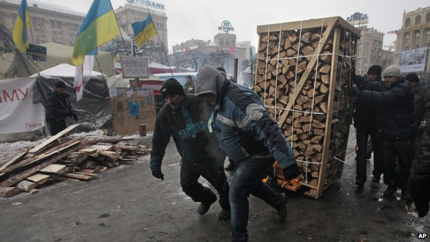 Protesters drag firewood through Kiev, 10 December