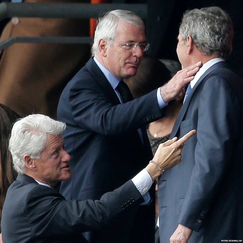 Former British Prime Minister John Major (centre) greets former US Presidents George W Bush (right) and Bill Clinton (left)
