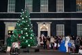 Guests gather for the lighting of a Christmas tree outside the  official residence of Britain's Prime Minister David Cameron