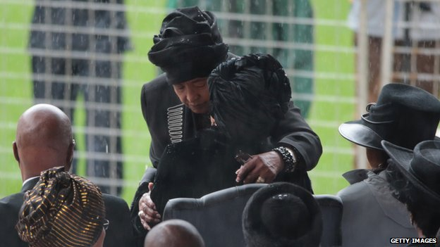 Winnie Madikizela-Mandela (L) and Graca Machel embrace