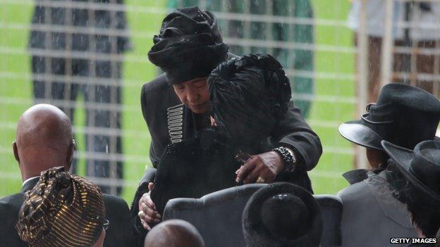 Winnie Madikizela-Mandela (L) and Graca Machel embrace