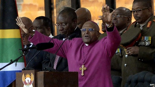 South Africa's archbishop emeritus Desmond Tutu gestures while delivering a speech during the memorial service for Nelson Mandela